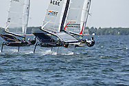 COCONUT GROVE, FL - DECEMBER 18, 2011.  Ten sailors took flight - literally - on Biscayne Bay at the Miami Winter Series Moth Regatta hosted by Coconut Grove Sailing Club.  It takes just 7 knots of wind to lift these hulls  out of the water.  Hydrofoils at the end of the centerboard and rudder provide lift.   [Images are priced online for editorial use.  For prints, contact the photographer at regatta.imagery@att.net.]