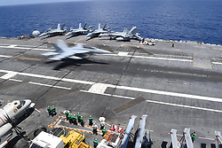 ATLANTIC OCEAN (Aug. 1, 2018) An F/A-18 Super Hornet assigned to Strike Fighter Squadron (VFA) 143 lands on the flight deck aboard the Nimitz-class aircraft carrier USS Abraham Lincoln (CVN 72). Abraham Lincoln is currently conducting tailored ship's training availability and final evaluation problem (TSTA/FEP). TSTA prepares the ship and crew for full integration into a carrier strike group through a wide range of mission-critical operations. (U.S. Navy photo by Mass Communication Specialist Seaman Will Hardy/Released) 180801-N-RG171-1215