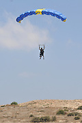 Tandem paragliding Instructor and trainee tied together during the jump.