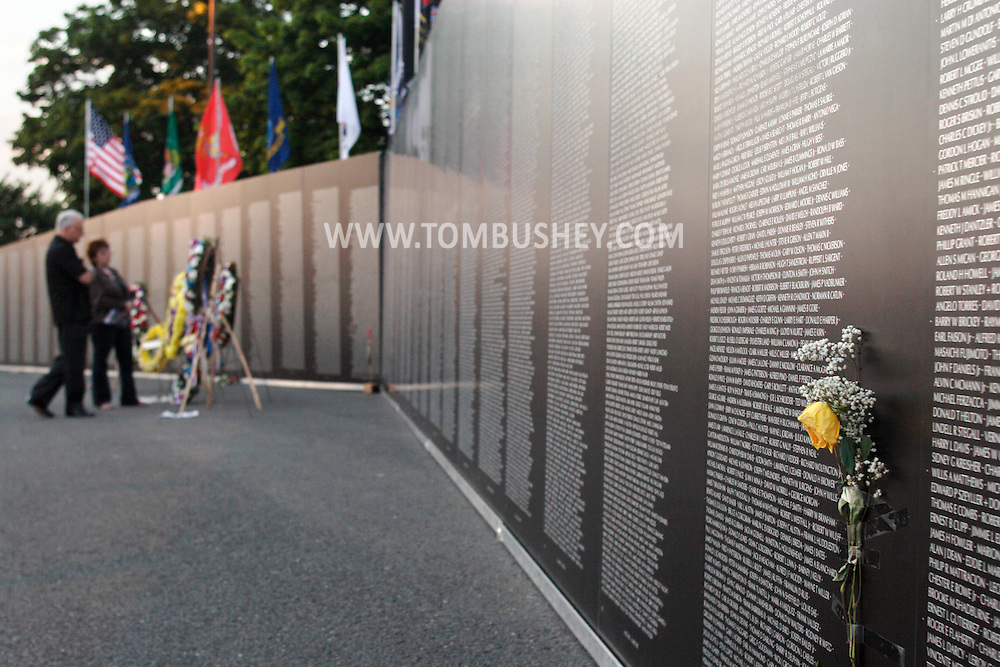 Newburgh, NY - A yellow rose is taped to the Vietnam Veterans Memorial Traveling Wall at Stewart International Airport on June 6, 2009.