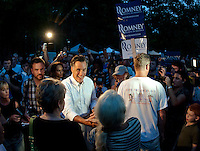 Mitt Romney greets supporters in the crowd gathered at Rollins Park in Concord after speaking at the Tea Party Express Tour Sunday evening.  (Karen Bobotas/for the Concord Monitor)
