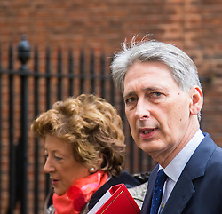 Downing Street, London, December 8th 2015. Baroness Anelay and Foreign Secretary Philip Hammond leave  Downing Street following the weekly cabinet meeting.