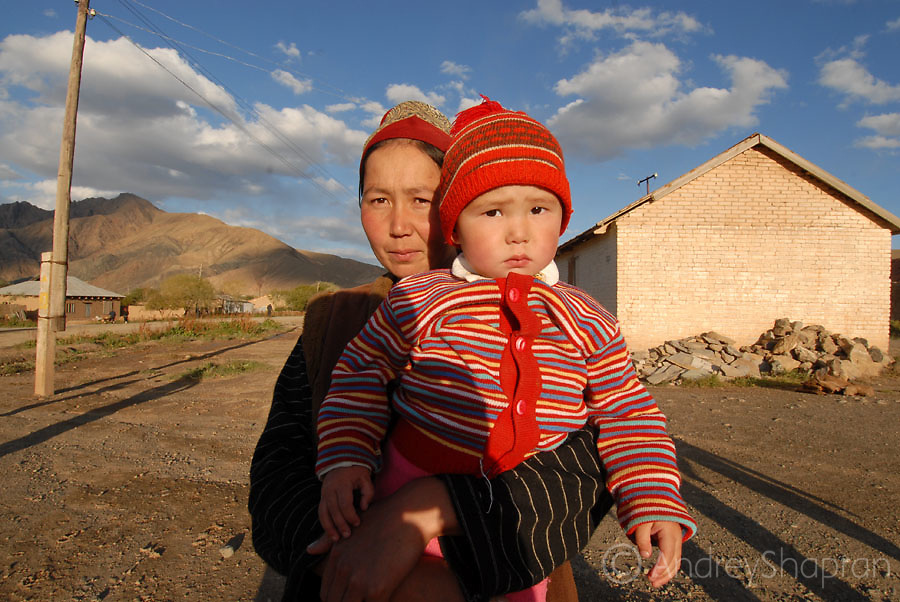 Telek village. A portrait with a kid