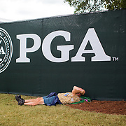 CHARLOTTE, NC - AUGUST, 8 2017: A man takes a load off at the 2017 PGA Championship at Quail Hollow Club on the second day of practice before the start of the tournament.