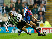 Photo. Jed Wee<br /> Newcastle United v Partizan Belgrade, European Champions League Qualifier, St. James' Park, Newcastle. 27/08/2003.<br /> Newcastle's Laurent Robert (L) lunges in to try to dispossess Partizan's Milivoje Cirkovic.