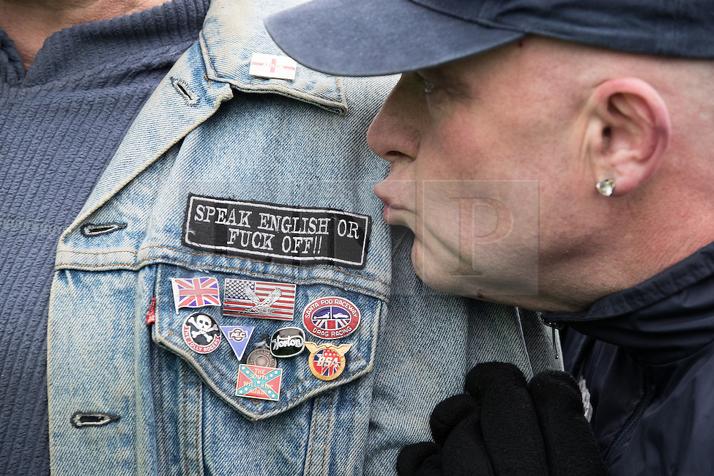"© Licensed to London News Pictures. 25/02/2017. Telford, UK. Badge reading "" Speak English or Fuck off "" on the jacket of a man at a Britain First demonstration in Telford , opposed by anti-fascist groups . Britain First say they are highlighting concerns about child sexual exploitation in the town . Photo credit: Joel Goodman/LNP"