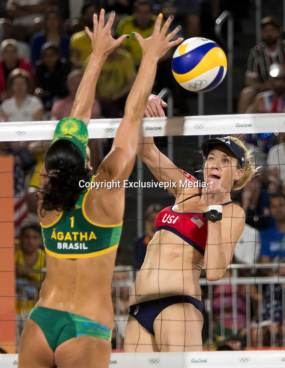 RIO DE JANEIRO, Aug. 17, 2016  <br /> <br /> Bums on show at the Volleyball at Olympics<br /> <br /> OLYMPICS BEACH VOLLEYBALL:  Kerri Walsh Jennings (USA)  ball is blocked by Agatha Rippel Bednarczuk (BRA) in the semifinals at Beach Volleyball Arena during the 2016 Rio Summer Olympics games.<br /> &copy;Exclusivepix Media