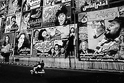 Cairo, Egypt, 1999 - Hand painted cinema and movie billboards cover a building site in Midan Orabi, downtown Cairo.