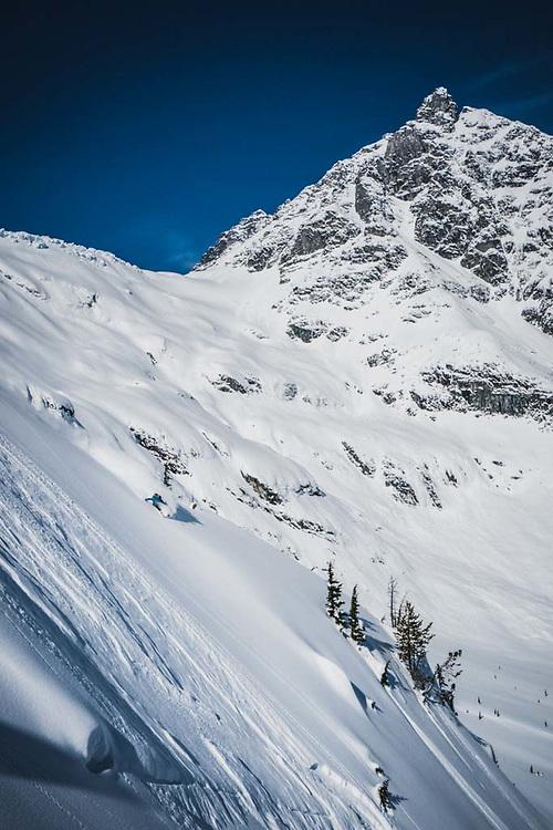 Dropping! Simon Thomson skiing below Loft Peak Glacier, howson Range, British Columbia.