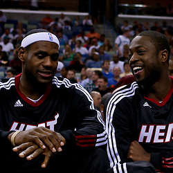 October 13, 2010; New Orleans, LA, USA; Miami Heat small forward LeBron James (6) and shooting guard Dwyane Wade (3) watch from the bench during the second half of a preseason game against the New Orleans Hornets at the New Orleans Arena. The Hornets defeated the Heat 90-76. Mandatory Credit: Derick E. Hingle