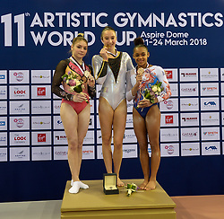 Gold medalist Derwael Nina (C) of Belgium silver medalist Perebinosova Uliana (L) of Russia Taipei and bronze medalist De Jesus Dos Santos Melanie (R) of France pose during the awarding ceremony of the Women's Uneven Bars final at the 11th FIG Artistic Gymnastics World Cup in Doha, Capital of Qatar, on March 23, 2018. (Credit Image: © Nikku/Xinhua via ZUMA Wire)