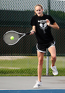Prairie's Caroline Rainey, junior, returns the ball to Xavier's Elizabeth Hoffmann (not pictured) during their match in the 1st round of the Regional Tennis Tournament at Xavier High School in Cedar Rapids on Saturday, May 15, 2010. Hoffmann defeated Rainey 6-0, 6-0 and Xavier defeated Prairie 5-0.