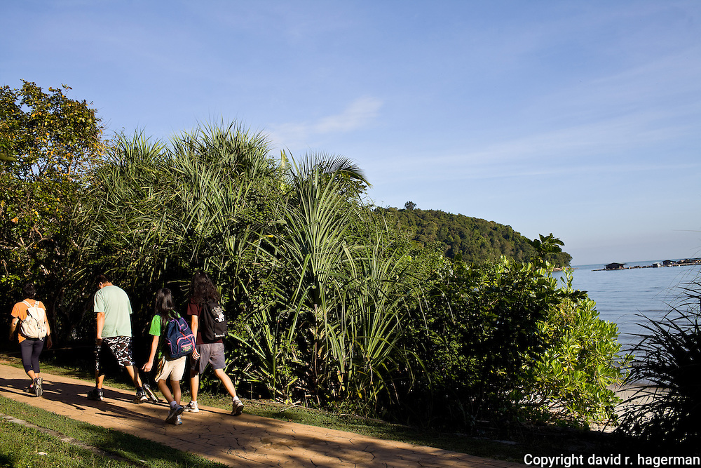 hiking along the coastline in Taman Negara Pulau Pinang