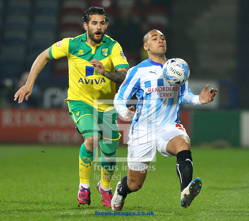 Bradley Johnson of Norwich and James Vaughan of Huddersfield Town in action during the Sky Bet Championship match at the John Smiths Stadium, Huddersfield<br /> Picture by Paul Chesterton/Focus Images Ltd +44 7904 640267<br /> 17/03/2015