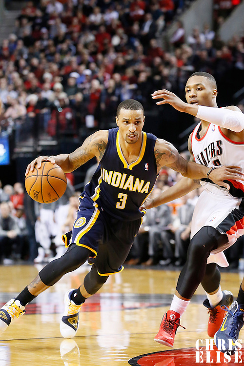 02 December 2013: Indiana Pacers point guard George Hill (3) drives past Portland Trail Blazers point guard Damian Lillard (0) during the Portland Trail Blazers 106-102 victory over the Indiana Pacers at the Moda Center, Portland, Oregon, USA.