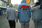 Group of teenagers, wearing hoodies, strolling through town, Amsterdam, Netherlands, 2000's