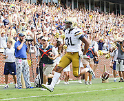 Georgia Tech Yellow Jackets running back Deon Hill (31) scores the go-ahead touchdown during Saturday's college football game against the Georgia Southern Eagles at Bobby Dodd Stadium in Atlanta. (Staff Photo: David Welker)