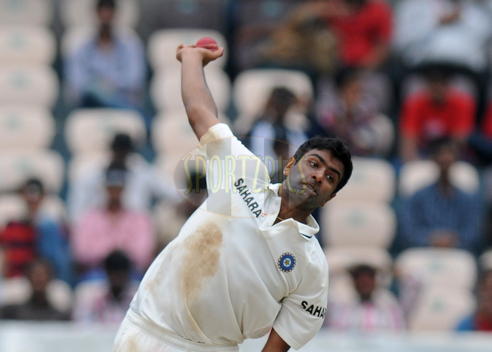 Ravichandran Ashwin of India bowls during day four of the first test match between India and New Zealand held at The Rajiv Gandhi International Stadium in Hyderabad, India on the 26th August 2012..Photo by: Pal Pillai/BCCI/SPORTZPICS