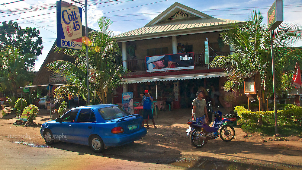 On the first day of January, 2010, it's back to business as usual for the local corner market on Panglao Island in the Visayas Province of the Philippines.