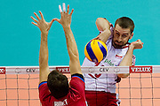 Marcin Mozdzonek from Poland in action during the 2013 CEV VELUX Volleyball European Championship match between Poland v Slovakia at Ergo Arena in Gdansk on September 22, 2013.<br /> <br /> Poland, Gdansk, September 22, 2013<br /> <br /> Picture also available in RAW (NEF) or TIFF format on special request.<br /> <br /> For editorial use only. Any commercial or promotional use requires permission.<br /> <br /> Mandatory credit:<br /> Photo by &copy; Adam Nurkiewicz / Mediasport