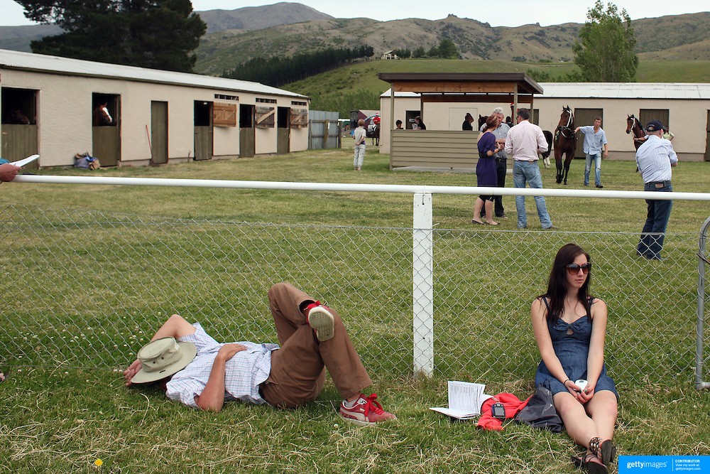 Spectators relax near the parade ring during a day at the Races at the Cromwell Race meeting, Cromwell, Central Otago, New Zealand. 27th November 2011. Photo Tim Clayton