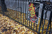 Autumn leaves and graffiti covering a Do Not Park sign, outside a Dulwich school, London borough of Southwark.