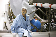 Young technician constructs European Space Agency's Automated Transfer Vehicle (ATV) Jules Verne module at Kourou Spaceport.