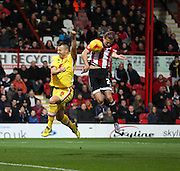 Brentford striker Lasse Vibe scoring the first goal of the game during the Sky Bet Championship match between Brentford and Milton Keynes Dons at Griffin Park, London, England on 5 December 2015. Photo by Matthew Redman.