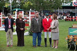 Eric Lamaze and John Fleischacker  owner of Hickstead, Linda Southern during revealing of the Hickstead statue.<br /> Spruce Meadows Masters - Calgary 2012<br /> © Dirk Caremans