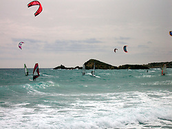 ITALY SARDINIA CHIA 28SEP07 - Surfers and kites in the waves at the beach in Chia near Domus de Maria, Sardinia, Italy.<br /> <br /> jre/Photo by Jiri Rezac<br /> <br /> © Jiri Rezac 2007<br /> <br /> Contact: +44 (0) 7050 110 417<br /> Mobile:  +44 (0) 7801 337 683<br /> Office:  +44 (0) 20 8968 9635<br /> <br /> Email:   jiri@jirirezac.com<br /> Web:    www.jirirezac.com<br /> <br /> © All images Jiri Rezac 2007 - All rights reserved.