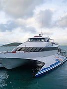A Whitsunday Island Cruise boat arrives at Daydream Island; Whitsunday Islands, QLD, Australia