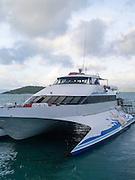 A Whitsunday Island Cruise boat arrives at Daydream Island; Whitsunday Islands, QLD, Australia