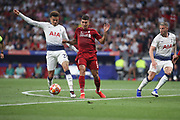 Roberto Firmino of Liverpool against Dele Alli of Tottenham Hotspur during the Champions League Final match between Tottenham Hotspur and Liverpool at Tottenham Hotspur Stadium, London, United Kingdom on 1 June 2019.