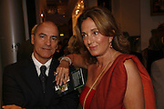 Silvio Pinto and Suzanna Adesana, Gala champagne reception and dinner in aid of CLIC Sargent.  Grosvenor House Art and Antiques Fair.  Grosvenor House. Park Lane. London. 15  June 2006. ONE TIME USE ONLY - DO NOT ARCHIVE  © Copyright Photograph by Dafydd Jones 66 Stockwell Park Rd. London SW9 0DA Tel 020 7733 0108 www.dafjones.com