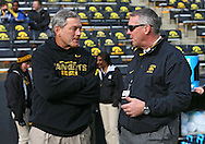 October 26 2013: Iowa Hawkeyes head coach Kirk Ferentz talks with Iowa Athletic Director Gary Barta before the start of the NCAA football game between the Northwestern Wildcats and the Iowa Hawkeyes at Kinnick Stadium in Iowa City, Iowa on October 26, 2013. Iowa defeated Northwestern 17-10 in overtime.
