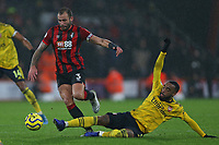Football - 2019 / 2020 Premier League - AFC Bournemouth vs. Arsenal<br /> <br /> Alexandre Lacazette of Arsenal slides in to tackle Bournemouth's Steve Cook during the Premier League match at the Vitality Stadium (Dean Court) Bournemouth  <br /> <br /> COLORSPORT/SHAUN BOGGUST