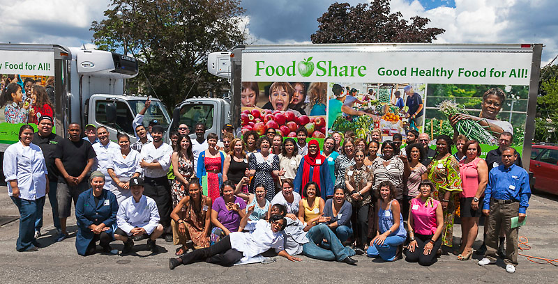 FoodShare's staff in front of the 2 new trucks at FoodShare's 2012 AGM.