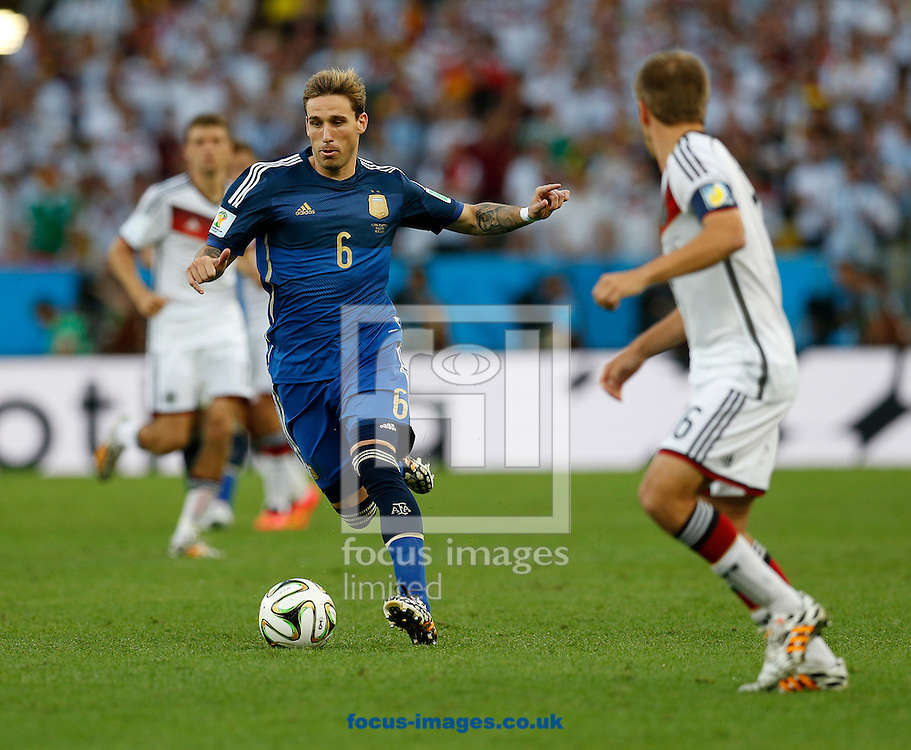 Argentina's Lucas Biglia attacks during the 2014 FIFA World Cup Final match at Maracana Stadium, Rio de Janeiro<br /> Picture by Andrew Tobin/Focus Images Ltd +44 7710 761829<br /> 13/07/2014