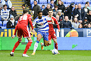 Reading FC striker Gareth McCleary closely guarded during the Sky Bet Championship match between Reading and Cardiff City at the Madejski Stadium, Reading, England on 19 March 2016. Photo by Mark Davies.