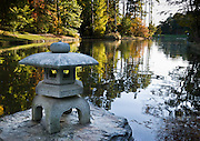 An ornamental Japanese stone lantern decorates the pond shore at Sarah P. Duke Gardens. Five miles of walks and pathways meander through landscaped and wooded areas at Sarah P. Duke Gardens at Duke University, Durham, North Carolina, USA. The gardens are divided into four parts, the Historic Core, the H.L Blomquist Garden of Native Plants, the Culberson Asiatic Arboretum and the Page White Garden. The gardens are a memorial to Sarah P. Duke, wife of Benjamin N. Duke, one of Duke University's benefactors. Address: Sarah P. Duke Gardens, .426 Anderson Street, Box 90341, Duke University, Durham, NC 27708-0341.