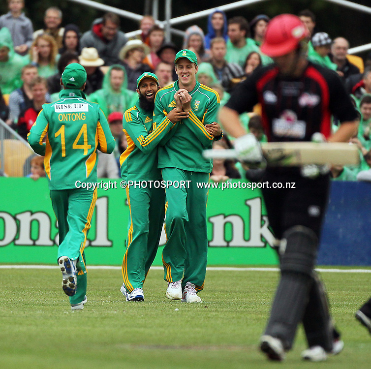 Morne Morkel takes the catch to remove George Worker with team mates Hashim Amla and Justin Ontong congratulating him. for South Afica. Canterbury Wizards v South Africa. International Twenty20 cricket match, Hagley Oval, Wednesday 15 February 2012. Photo : Joseph Johnson / photosport.co.nz