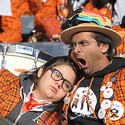 Members of The Princeton University Band relax between plays and performances during the Yale Vs Princeton, Ivy League College Football match at Yale Bowl, New Haven, Connecticut, USA. 15th November 2014. Photo Tim Clayton