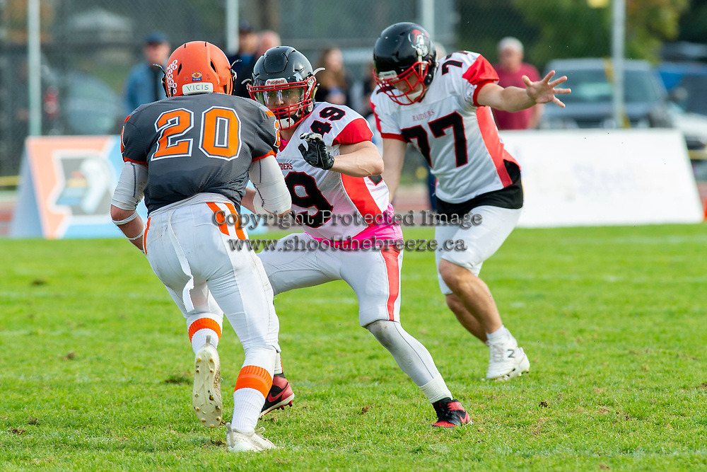 KELOWNA, BC - OCTOBER 6: Dominic Zenti #49 of the VI Raiders tries to tackle Tyler Going #20 of Okanagan Sun at the Apple Bowl on October 6, 2019 in Kelowna, Canada. (Photo by Marissa Baecker/Shoot the Breeze)