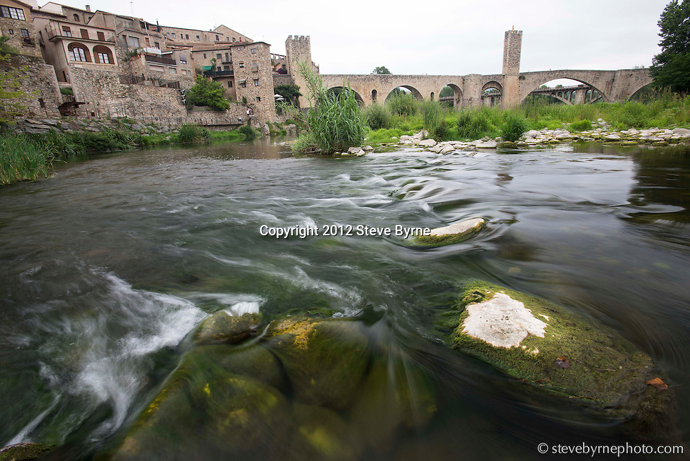 El Fluvia winds its way through the medieval village of Besalu, Catalonia.
