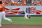 BALTIMORE, MD - JULY 13: Nate McLouth of the Baltimore Orioles dives but can't make the catch during the game against the Toronto Blue Jays at Oriole Park at Camden Yards on July 13, 2013 in Baltimore, Maryland. The Blue Jays won 7-3. (Photo by Joe Robbins)