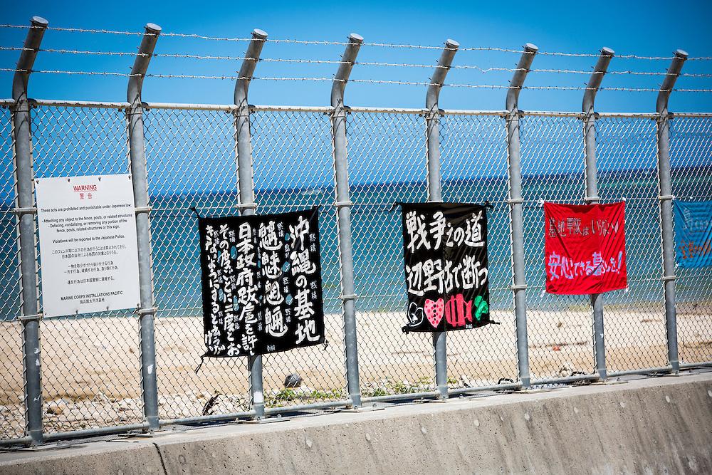 OKINAWA, JAPAN - JUNE 18 : Protest signs are attached in the fence of U.S. Marine base Camp Schwab in Nago, Okinawa, Japan,  June 18, 2016. Photo: Richard Atrero de Guzman