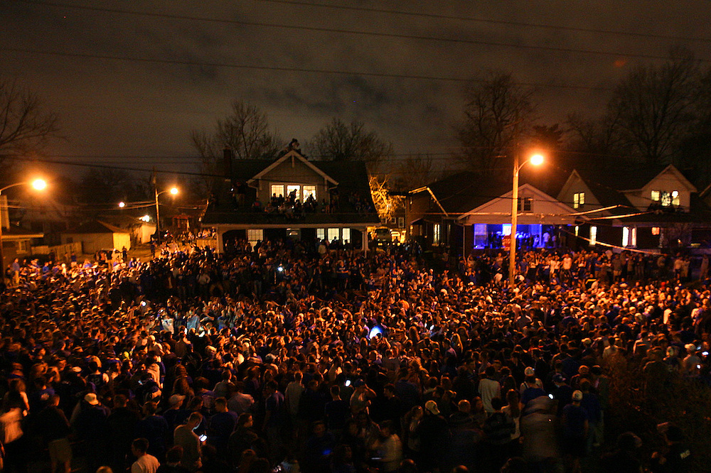 Fans surround the intersection of State and Elizabeth St. to celebrate Kentucky's win over arch-rival Louisville.