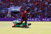 Football - 2016 / 2017 Premier League - AFC Bournemouth vs. Manchester United<br /> Manchester United's David de Gea just gets to the ball in front of Bournemouth's Benik Afobe to foil the strikers run on goal at Dean Court (The Vitality Stadium) Bournemouth<br /> <br /> Colorsport/Shaun Boggust