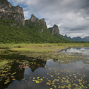"Khao Sam Roi Yot National Park, Thailand. Khao Sam Roi Yot means ""The mountain with three hundred peaks"" and refers to a series of limestone hills along the Gulf of Thailand"