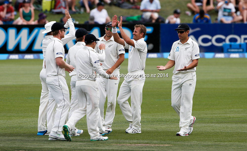 Neil Wagner and NZ celebrate a wicket. Day 2, ANZ Boxing Day Cricket Test, New Zealand Black Caps v Sri Lanka, 27 December 2014, Hagley Oval, Christchurch, New Zealand. Photo: John Cowpland / www.photosport.co.nz